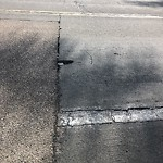 Pothole at 7325 Margerum Ave